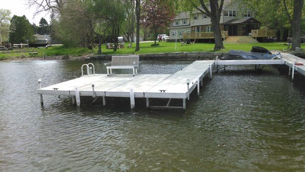 Picture if a uniquely shaped type of pier in a homeowners back yard.